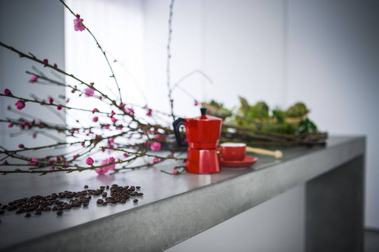 Image showing Dimano glass reinforced concrete kitchen bench with flowers and coffee pot