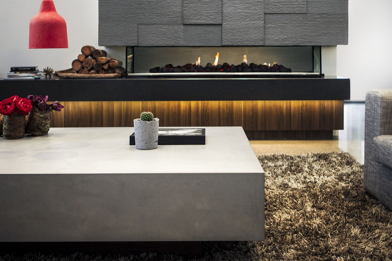 Image of Dimano glass reinforced concrete coffee table with concrete fire hearth in background